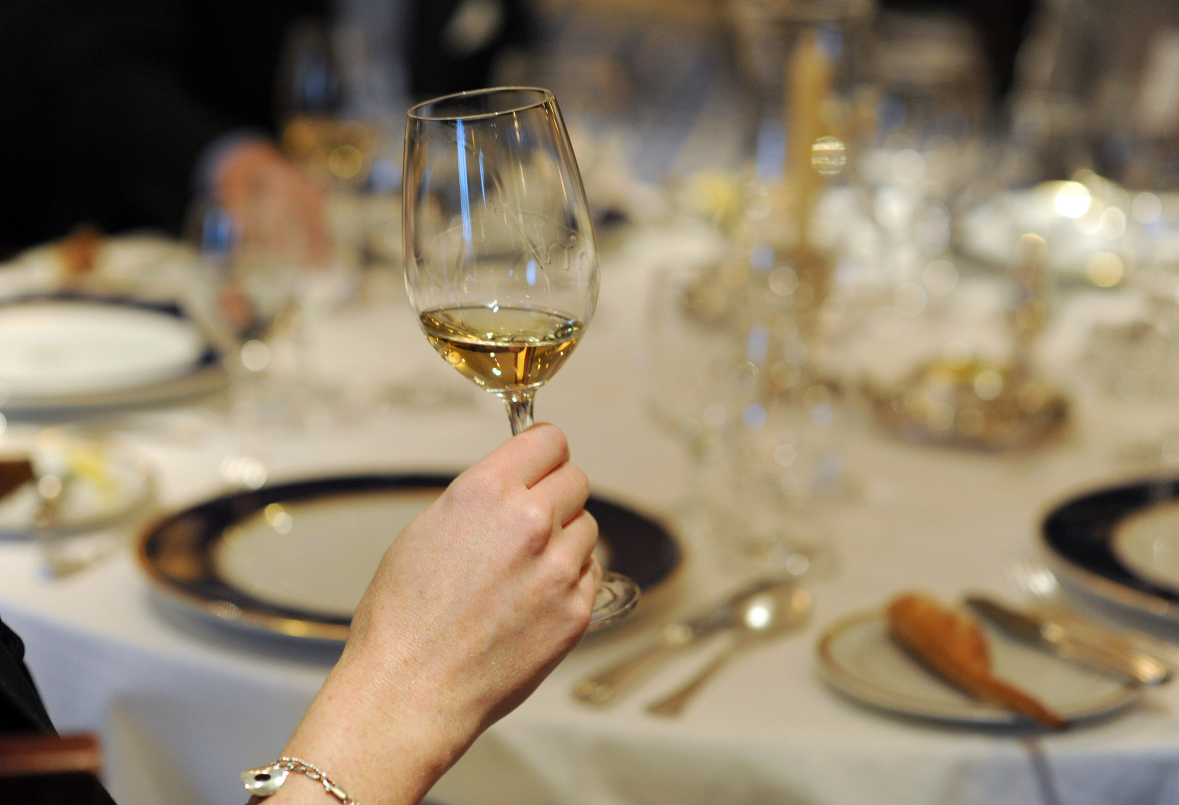 This photo taken Oct. 16, 2009, aboard Celebrity Constellation shows a wine-tasting demonstration, part of Celebrity's new program of enrichment semin...