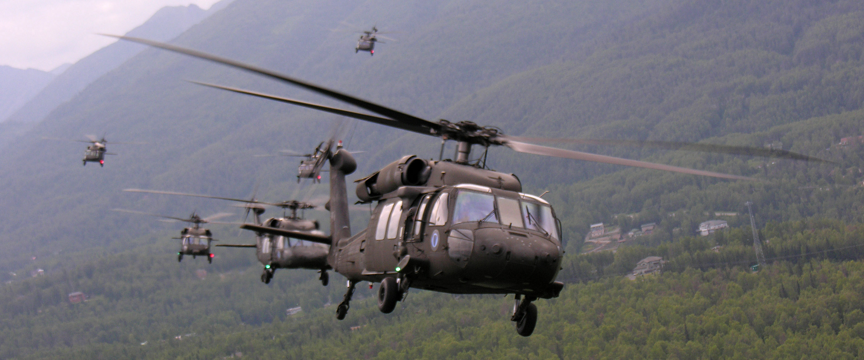 Six Alaska Army National Guard UH-60L Black Hawk helicopters bank over Eagle River in this July 2005 file photo. The United States is planning to sell...