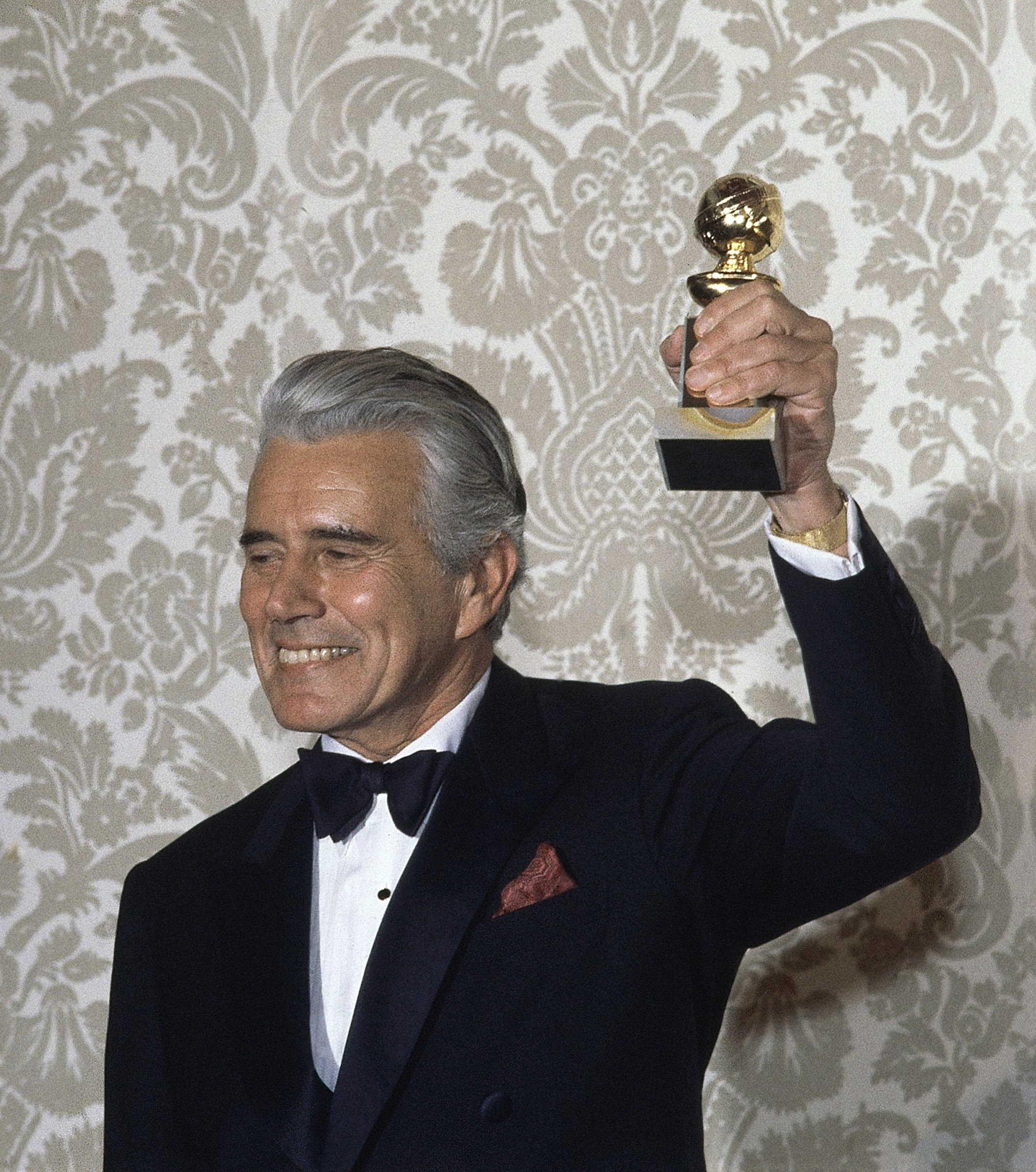 Actor John Forsythe celebrates after accepting the Golden Globe Award for best actor in a dramatic television series, 'Dynasty,' in Hollywood, Califor...