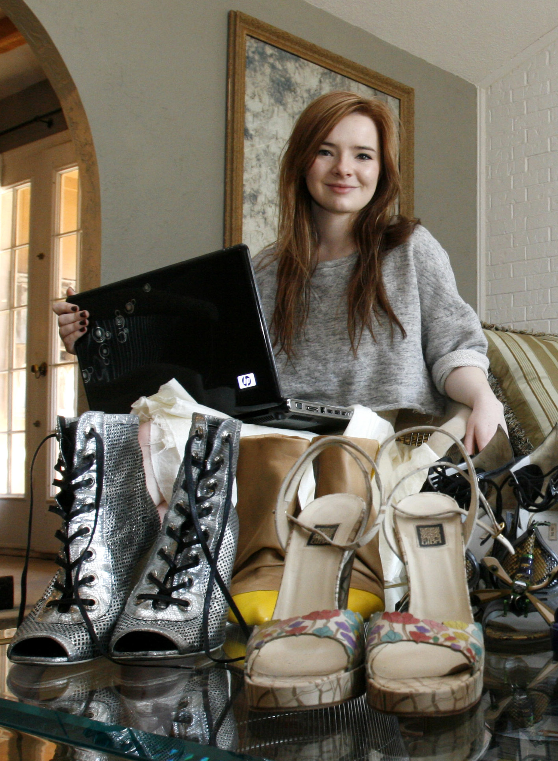 Jane Aldridge, 18, a fashion blogger on her site called 'Sea of Shoes', poses at her home in Trophy Club, Texas in this photo taken Feb. 9.