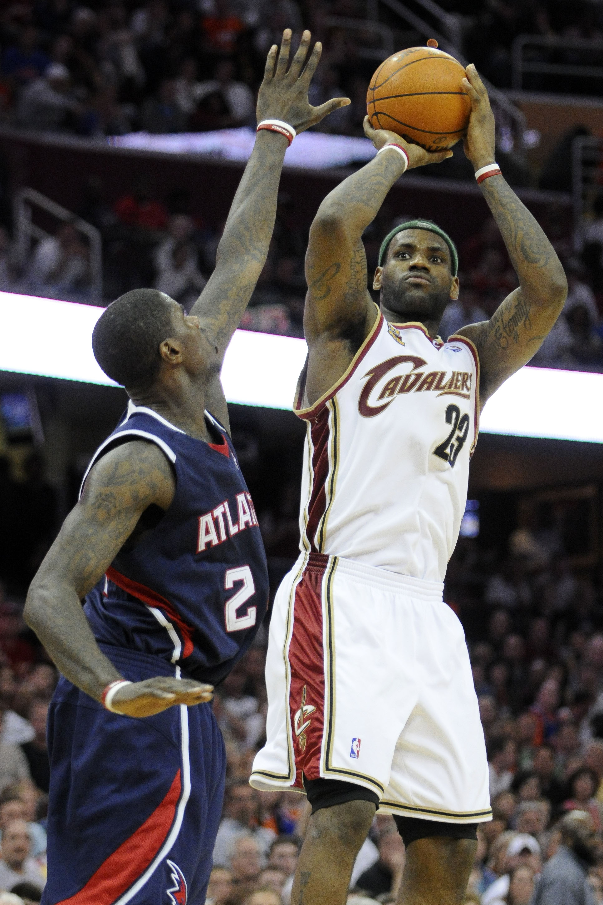 Cleveland Cavaliers forward LeBron James, right, shoots over Atlanta Hawks guard Joe Johnson during the fourth quarter of an NBA basketball game on Fr...