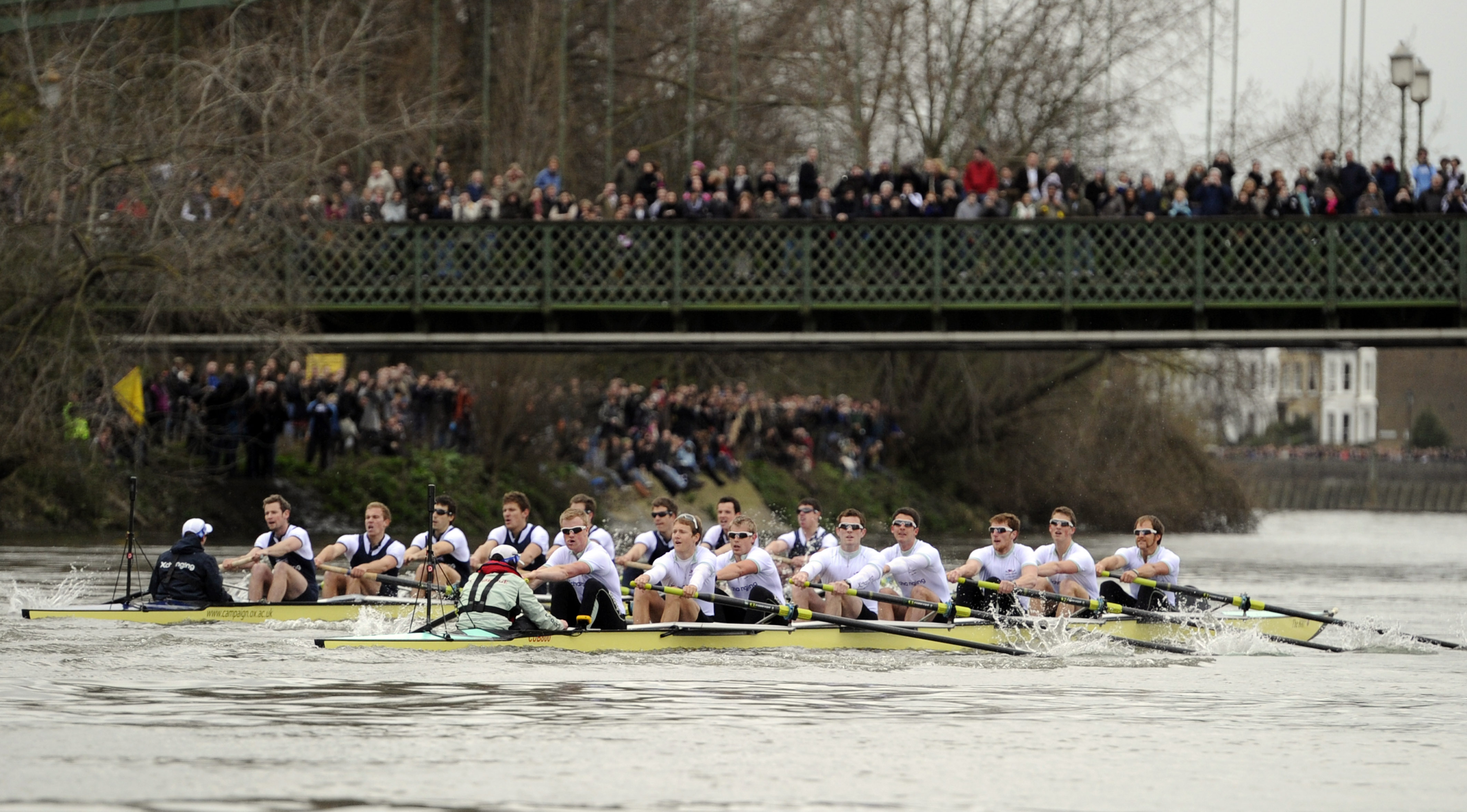 The Cambridge boat, right, approaches Hammersmith Bridge as they race against the Oxford boat, left, during the 156th running of the Boat Race, London...