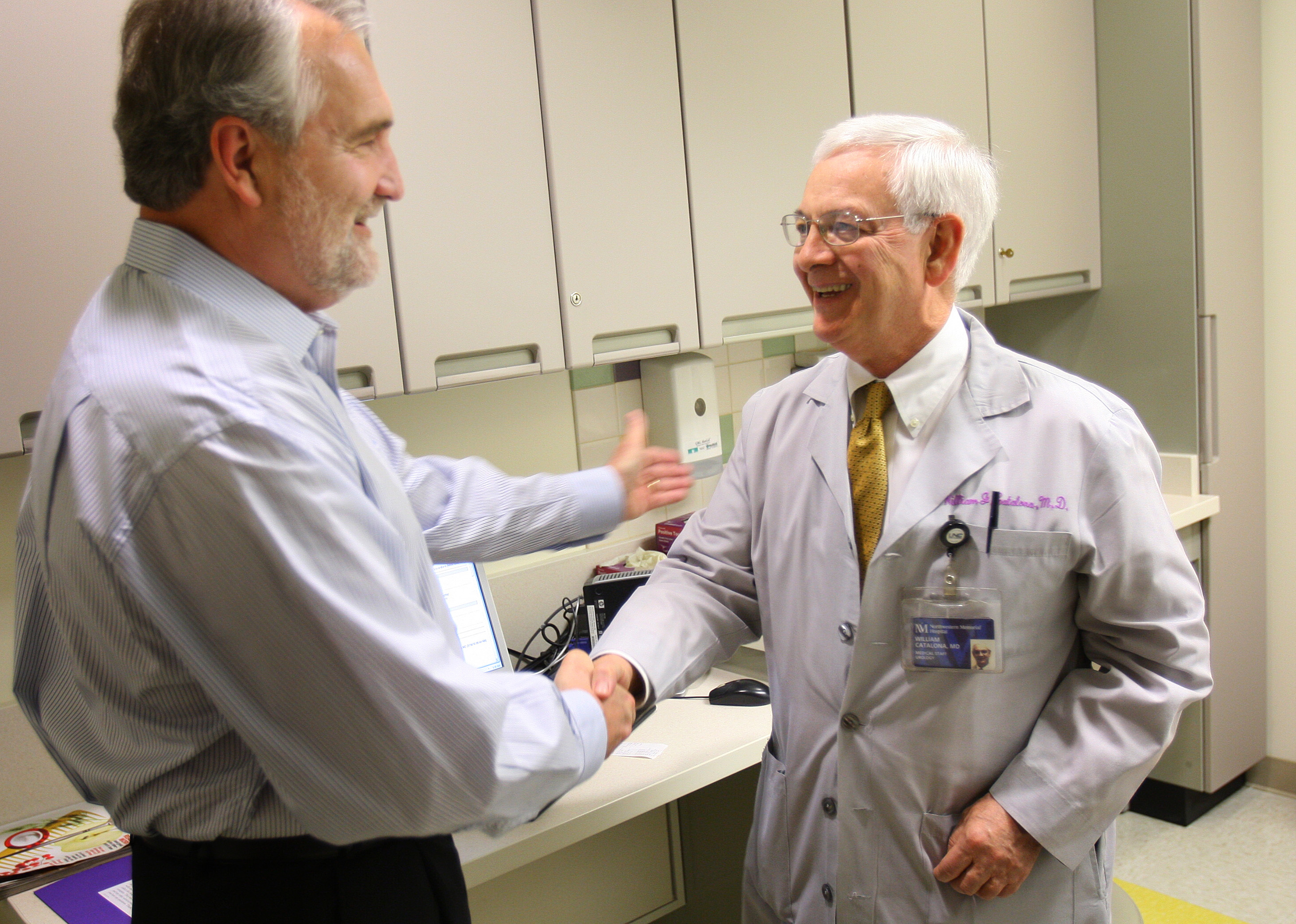 Dr. William Catalona, right, director of the prostate cancer program at Northwestern Memorial Hospital, speaks to patient Richard LaVerdiere on March ...