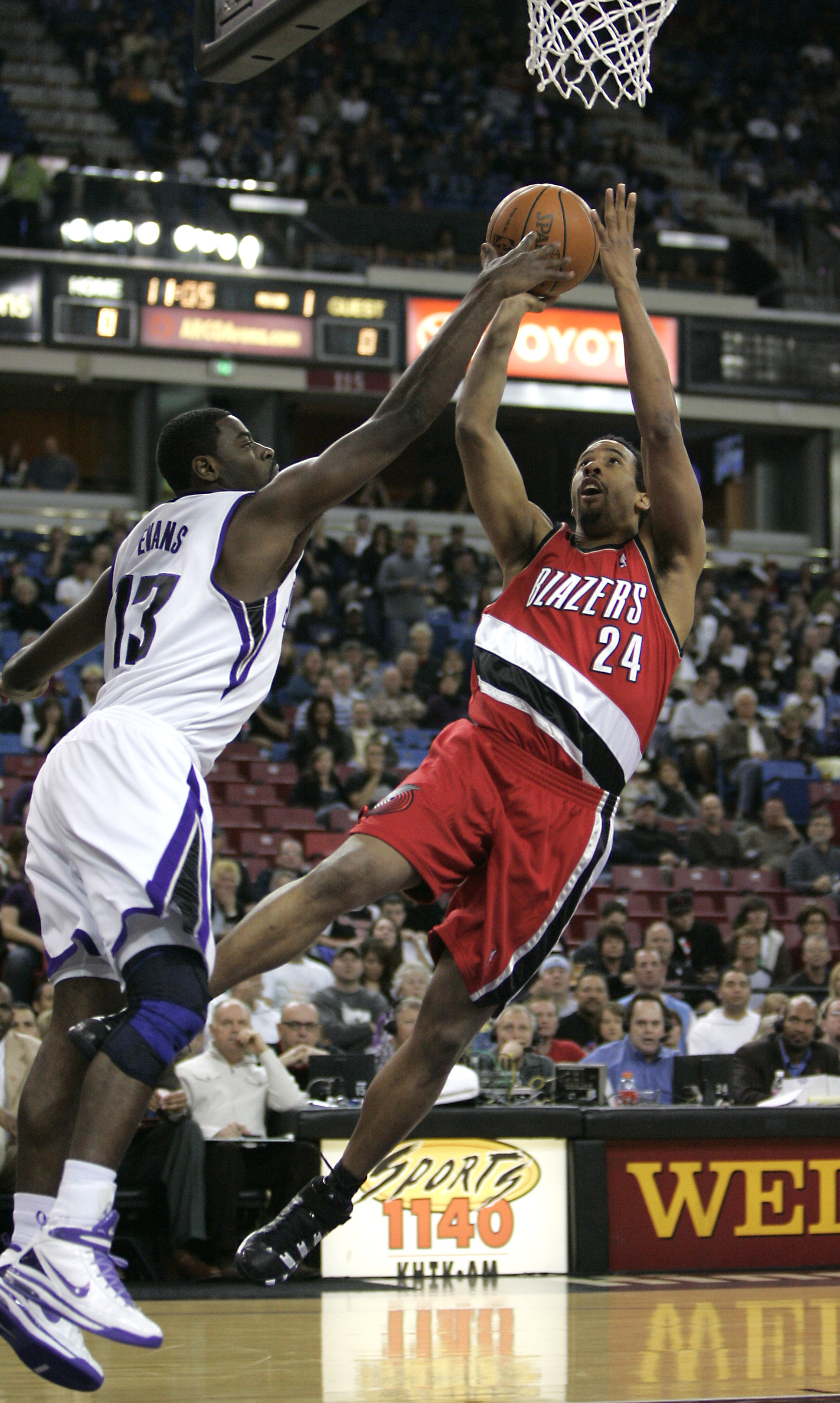 Portland Trail Blazers guard Andre Miller, right, tries to shoot over Sacramento Kings guard Tyreke Evans during the first quarter of an NBA basketbal...