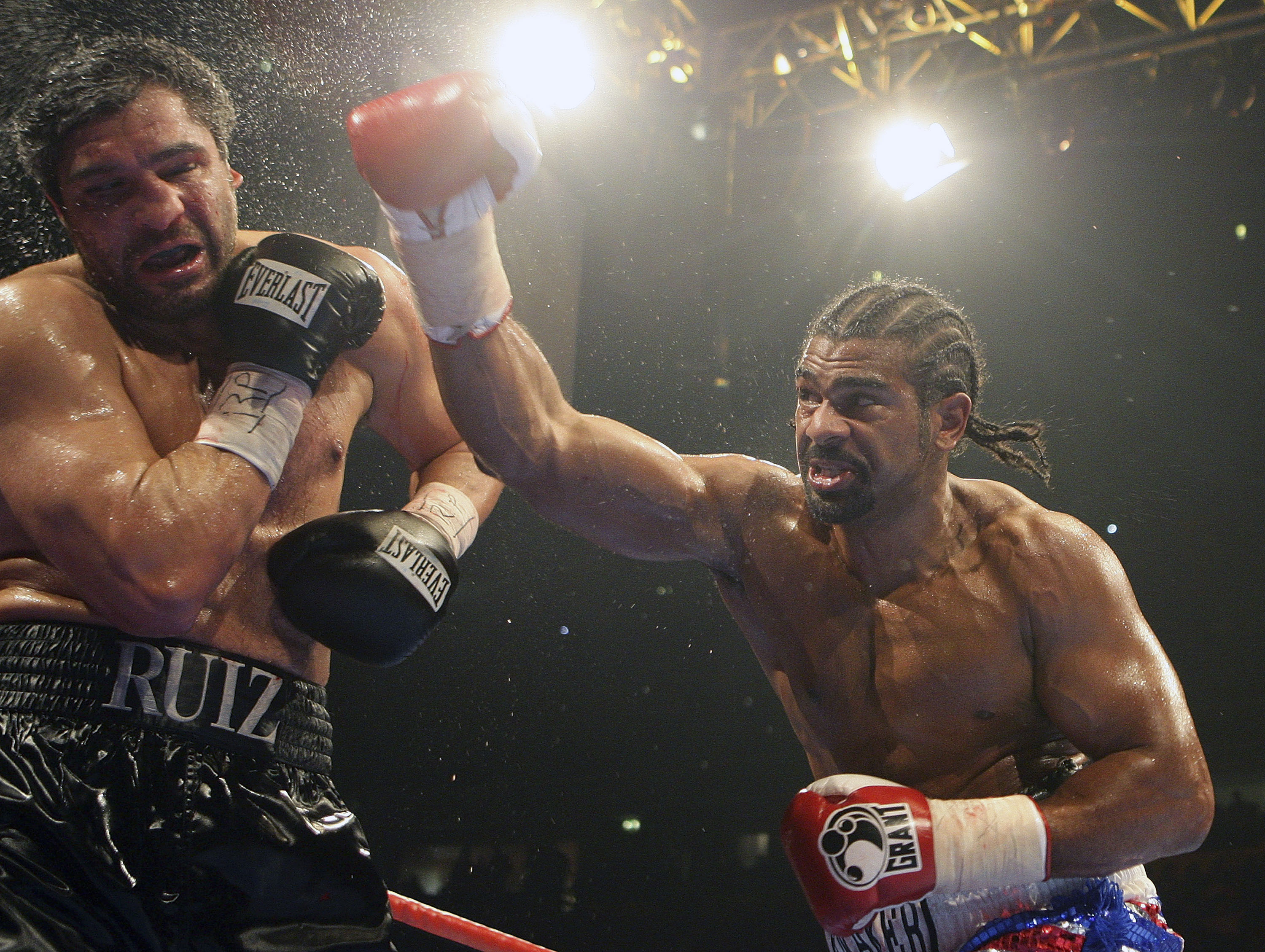 Britain's David Haye, right, throws a punch at John Ruiz of the USA, during their WBA Heavyweight World Championship boxing match at the MEN Arena in ...