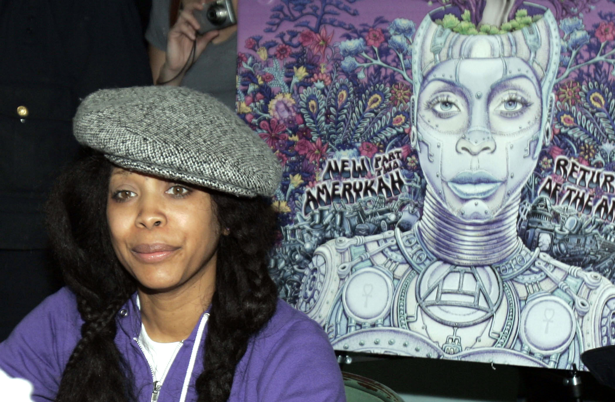 Singer Erykah Badu signs autographs for her new album 'New Amerykah, Pt. 2: Return of the Ankh' in Dallas, Texas on Saturday.
