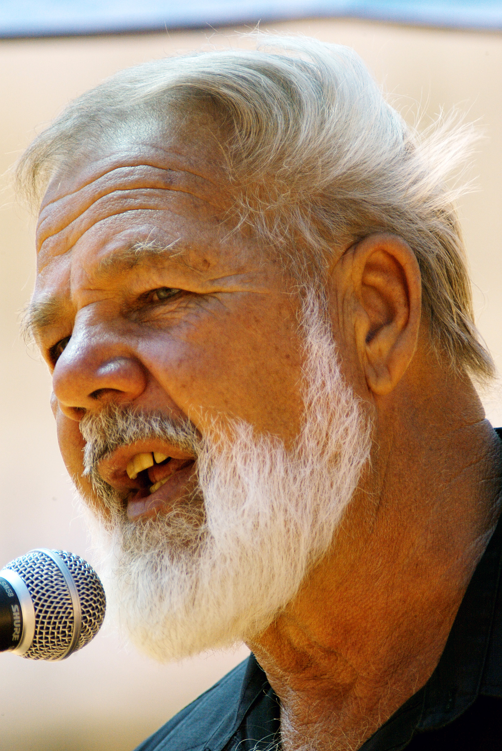 In this December 2005 file photo, South African white supremacist leader Eugene Terreblanche addresses followers at a rally held downtown Pretoria, So...