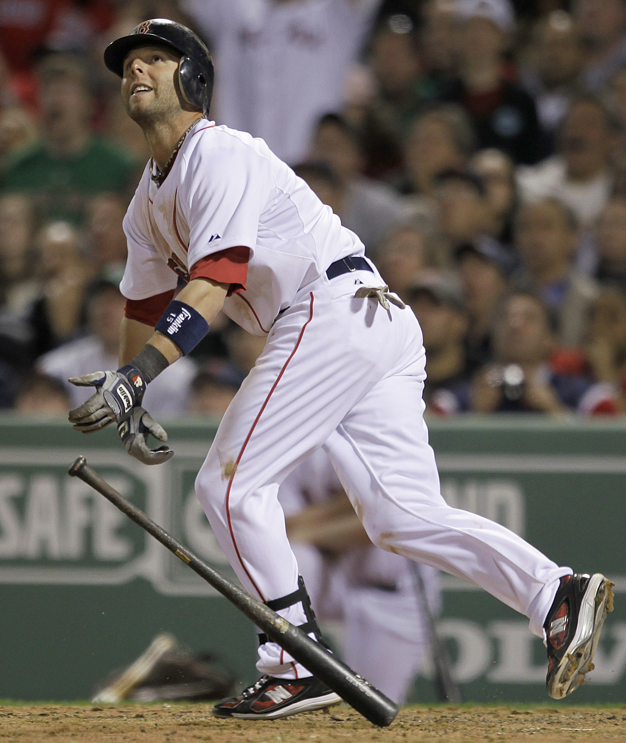Boston Red Sox's Dustin Pedroia watches his two-run home run against the New York Yankees in the seventh inning of the opening game of the baseball se...