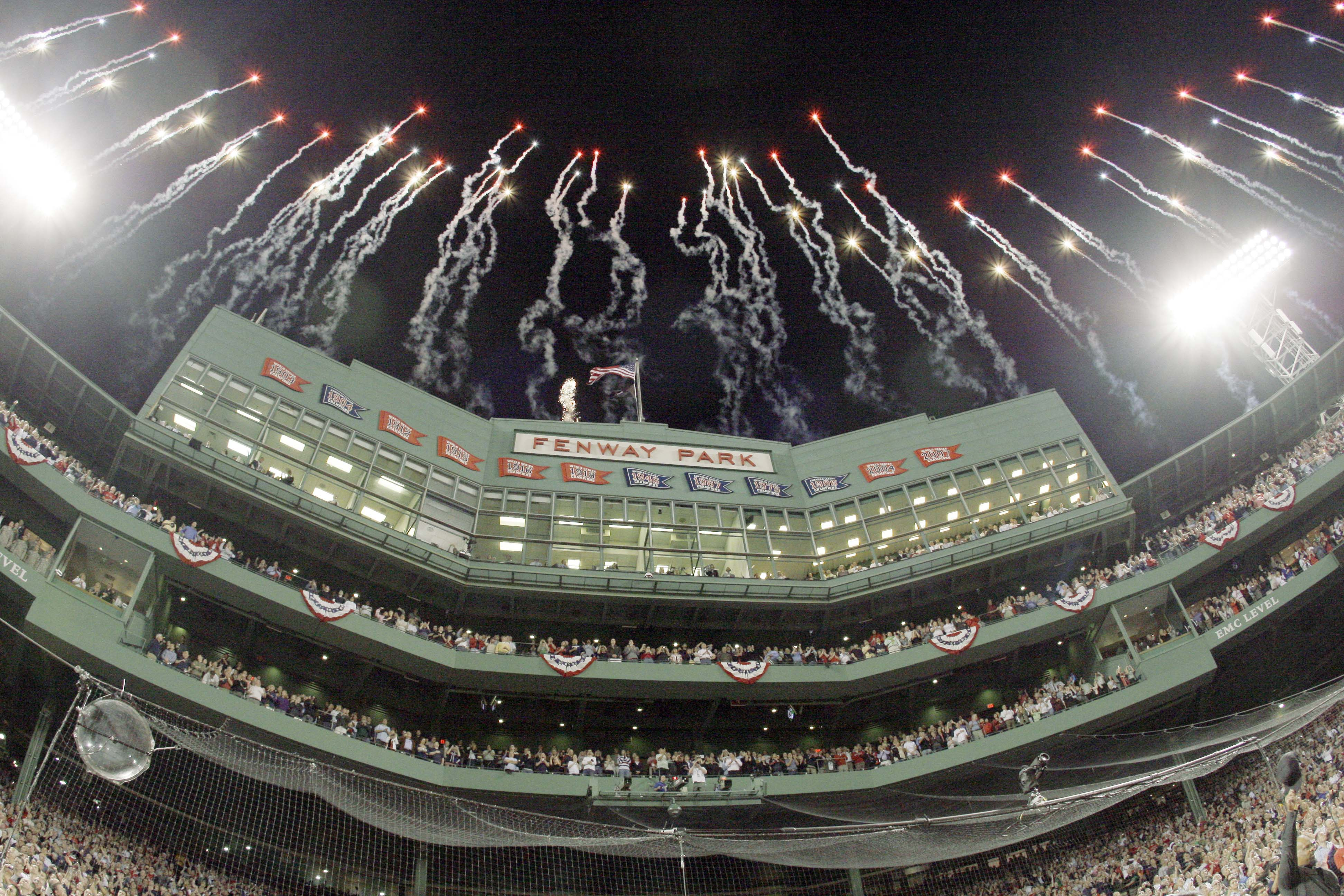 Fireworks soar over the Fenway Park pressbox before the opening game of the baseball season between the Boston Red Sox and New York Yankees on Sunday ...