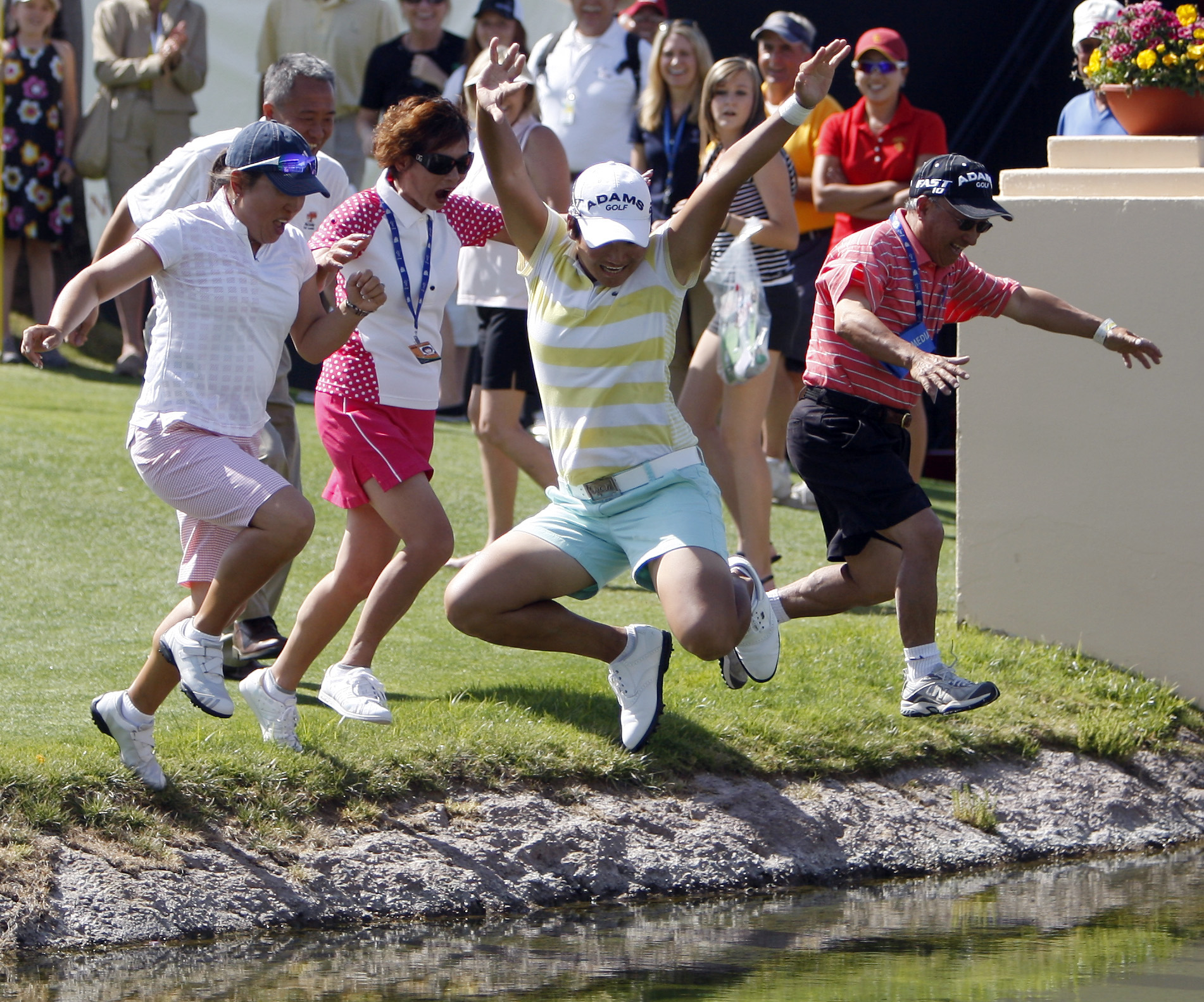 1. Yani Tseng, of Taiwan, celebrates by jumping into the pond with family and friends on the 18th hole after winning on the LPGA Kraft Nabisco Champio...