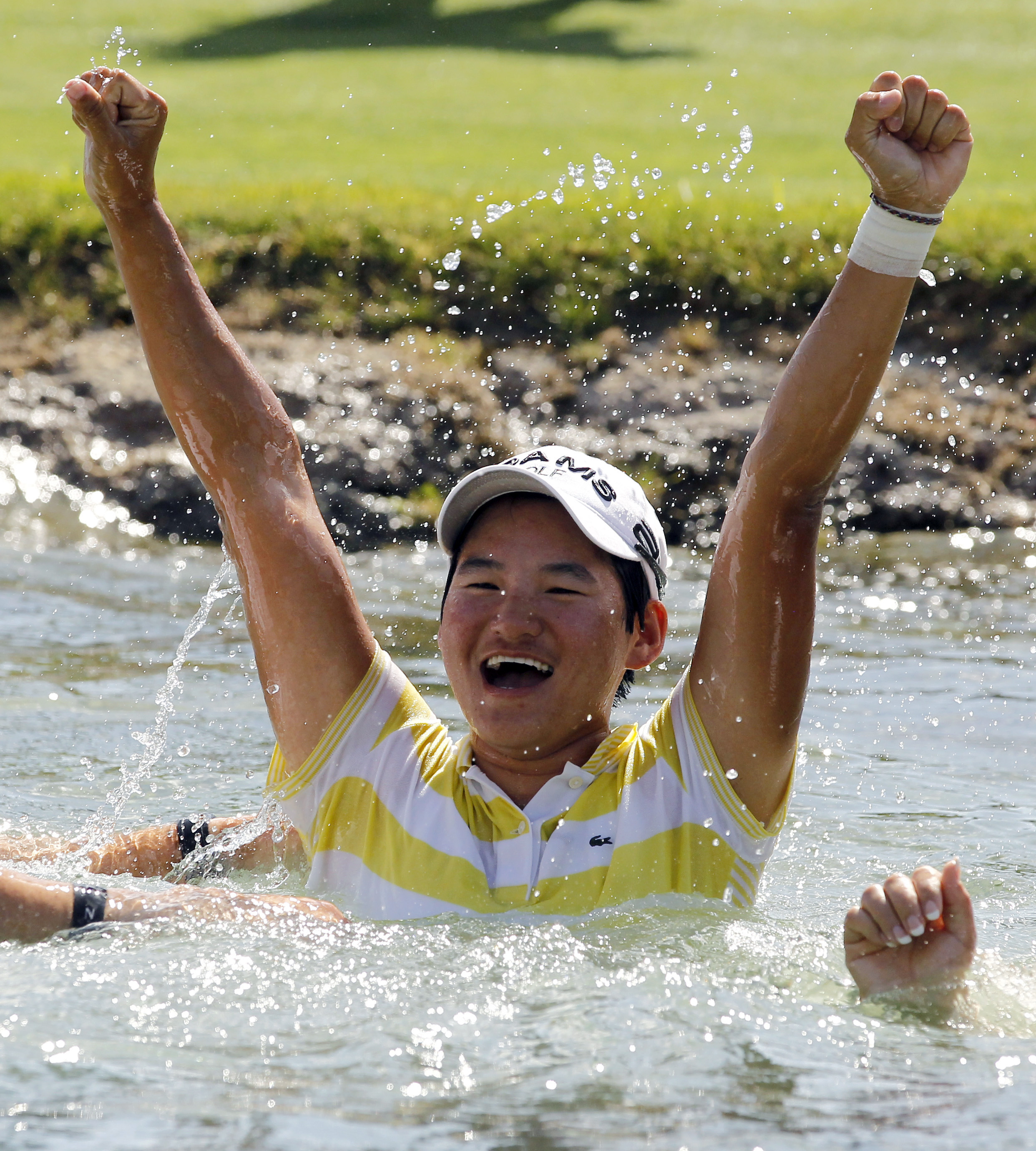3. Yani Tseng, of Taiwan, celebrates in the pond on the 18th hole after winning on the LPGA Kraft Nabisco Championship golf tournament in Rancho Mirag...