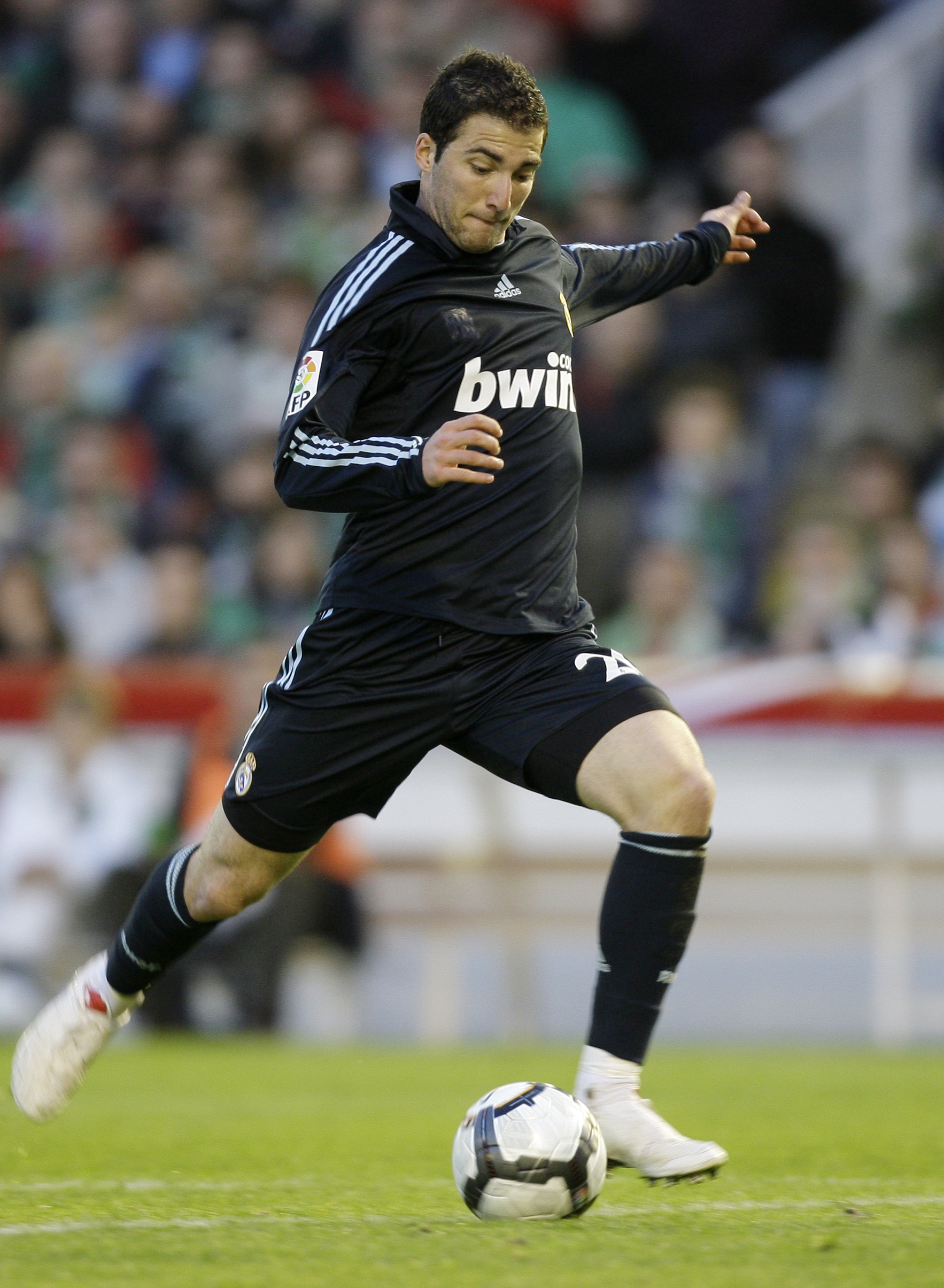 Real Madrid's Gonzalo Higuain from Argentina shoots to score during a Spanish La Liga soccer match against Racing Santander at El Sardinero stadium in...