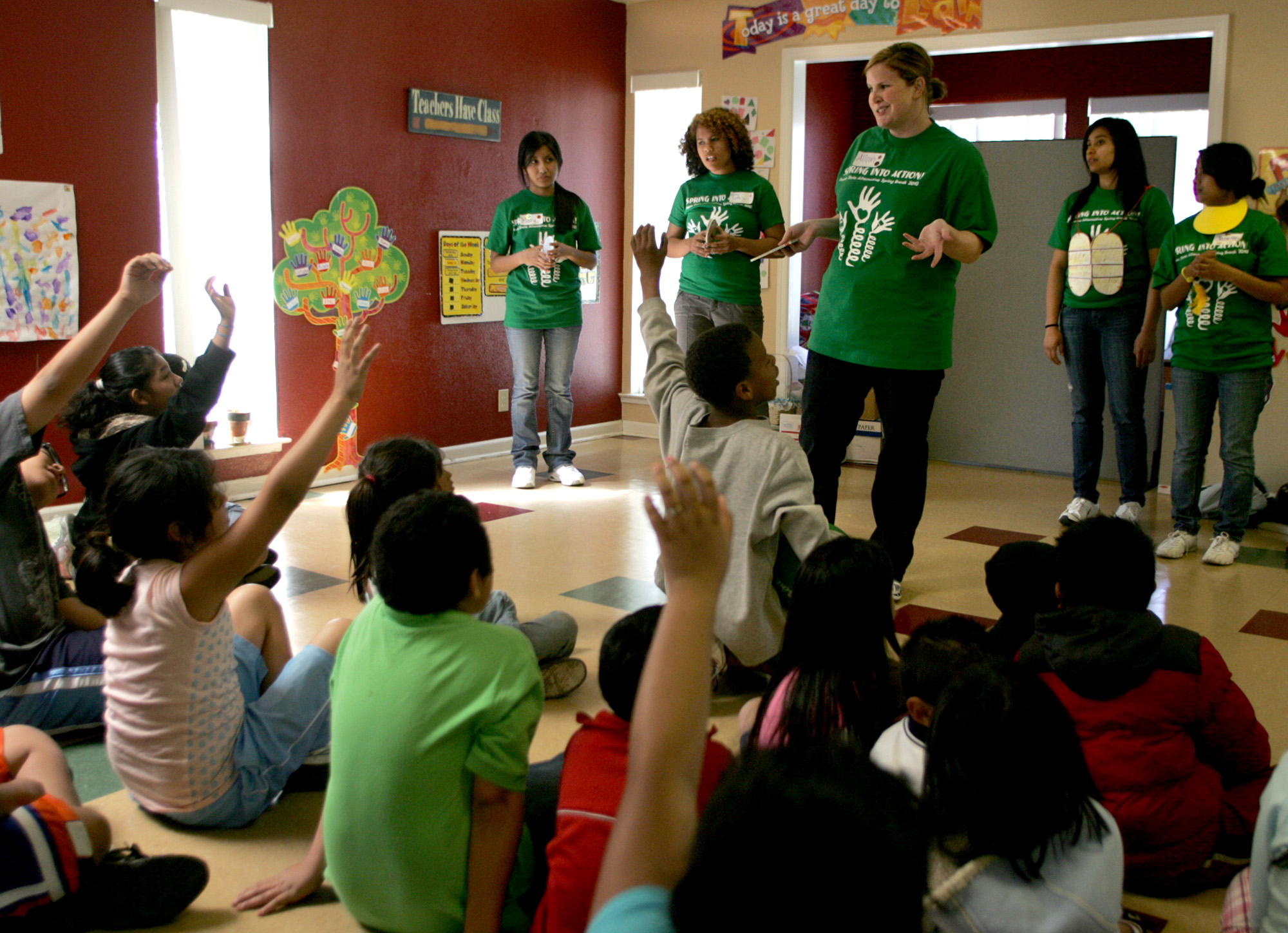 Fresno State student Alison Edwards, center, answers questions from kids after her group performed a play at Bigby Villa Apartments in Fresno, Califor...