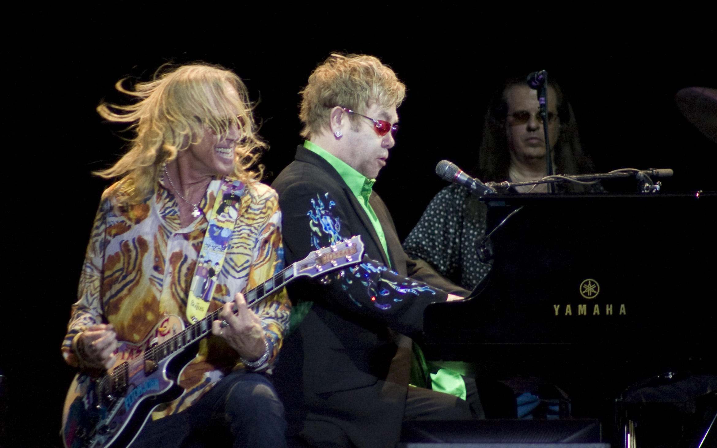 Britain's musician Elton John, center, performs during a concert at the Mayan ruins of Chichen Itza, Mexico on Saturday. Chichen Itza was named one of...