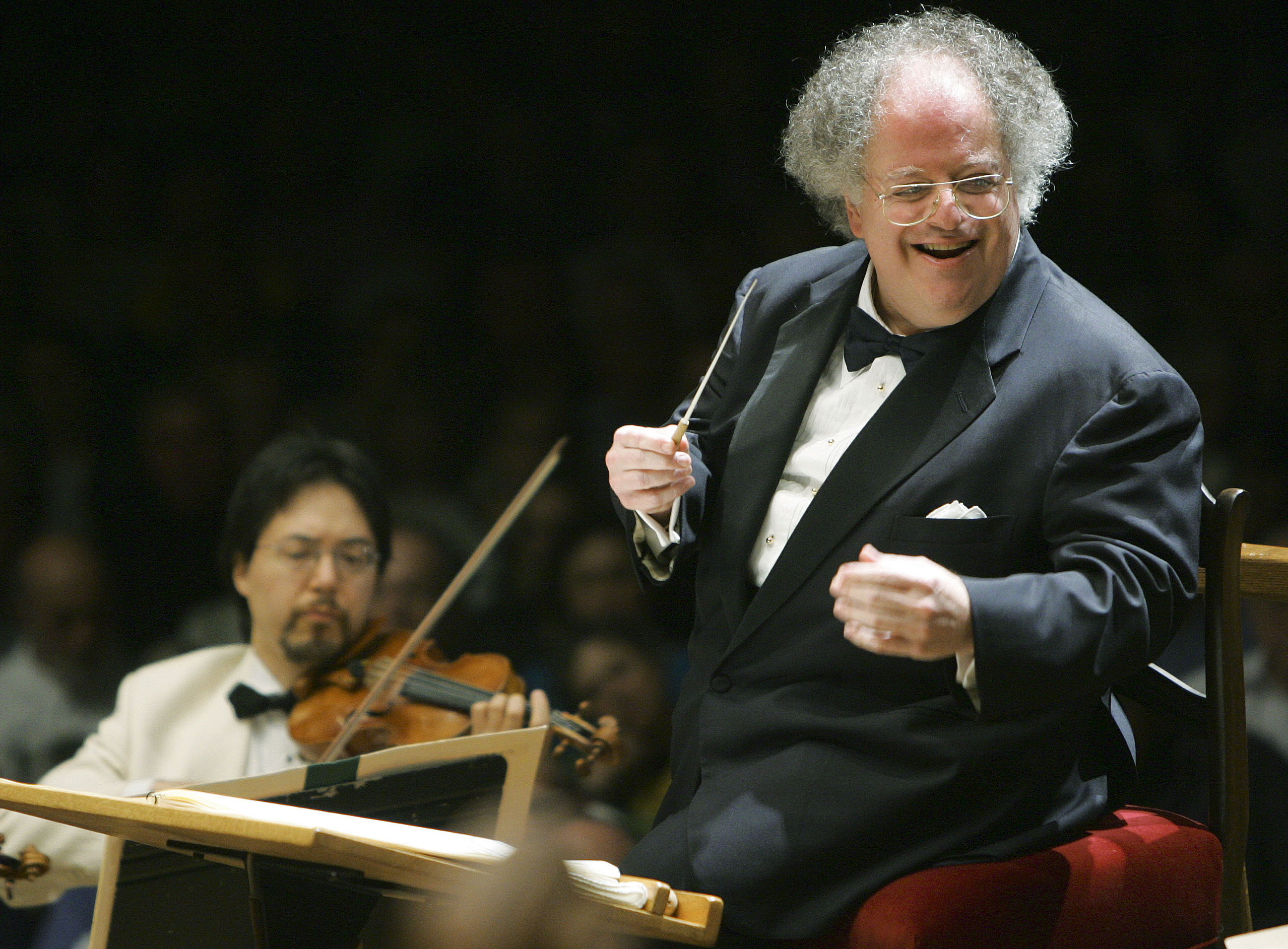 In this July 2006 file photo, Boston Symphony Orchestra music director James Levine, right, is shown conducting the symphony on its opening night perf...