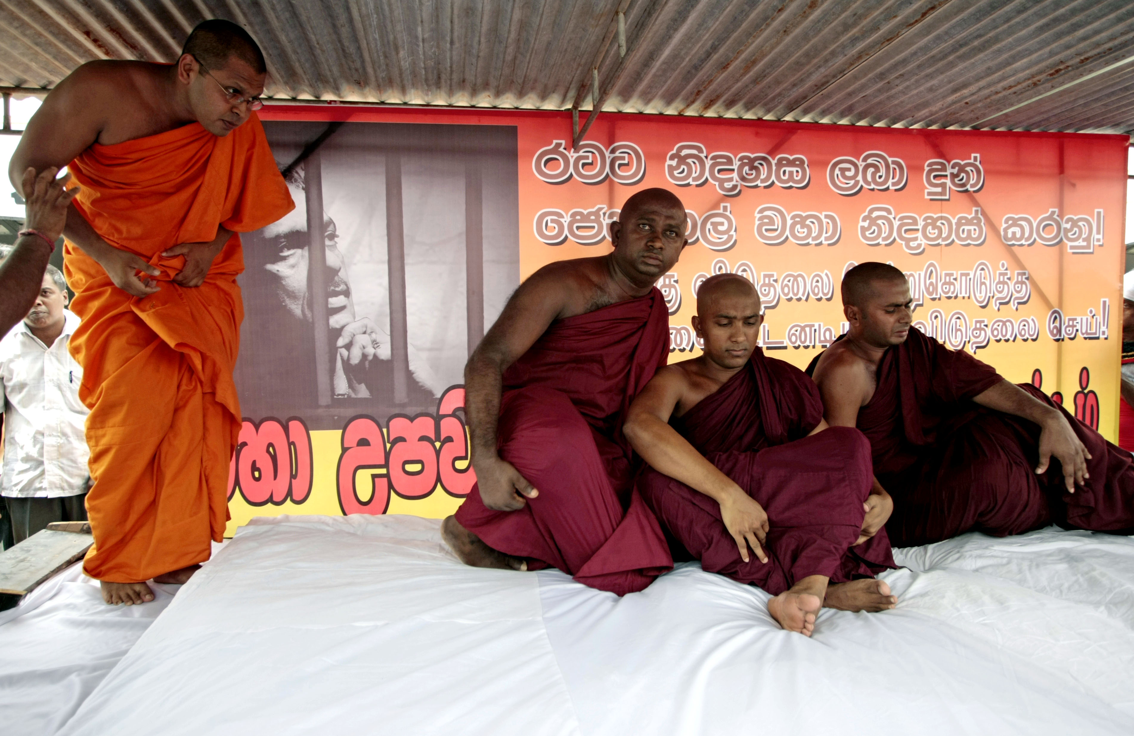Sri Lankan Buddhist monks, supporters of defeated presidential candidate Sarath Fonseka, participate in a protest in Colombo, Sri Lanka on Saturday.