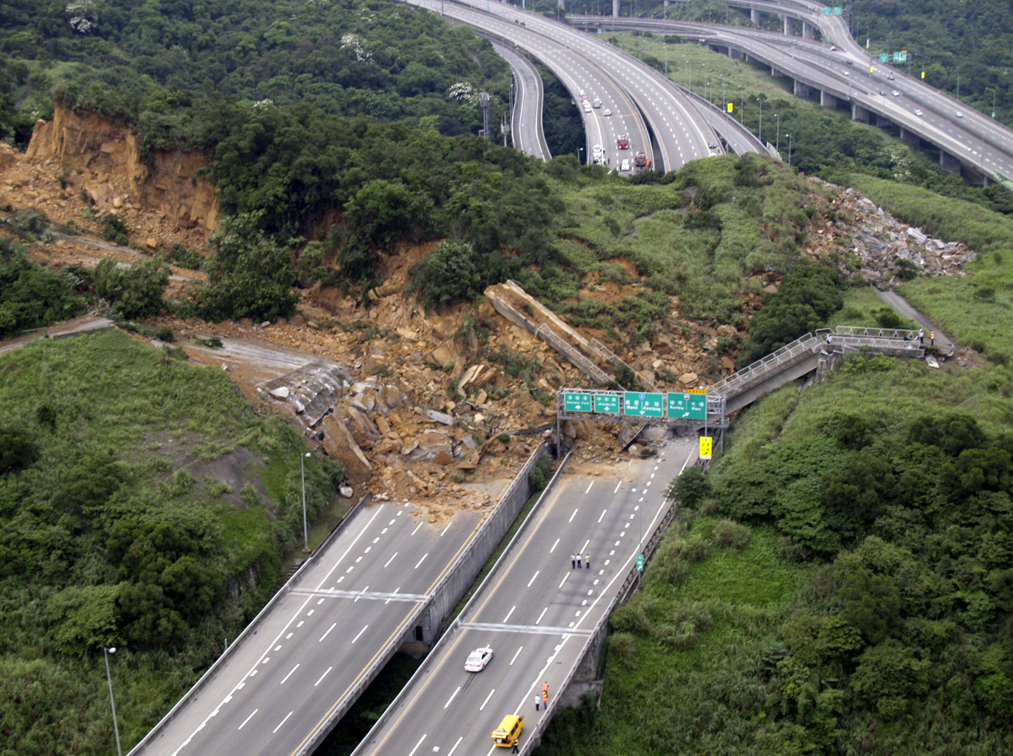 A landslide destroys portions of a major highway outside of the northeastern port city of Keelung, northern Taiwan is shown in this aerial image made ...