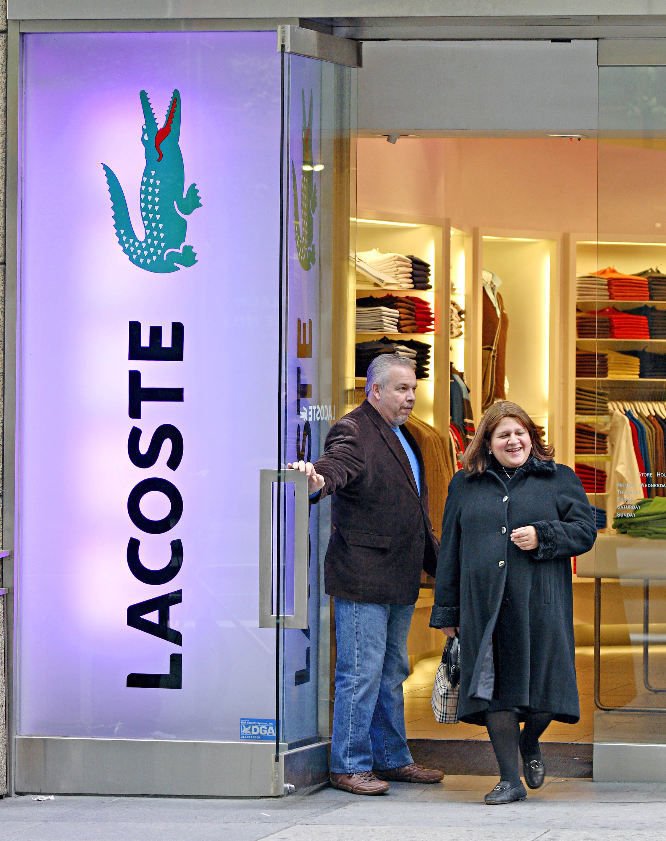 A shopper exits a Lacoste clothing store located on Madison Avenue in New York, New York in October 2006.