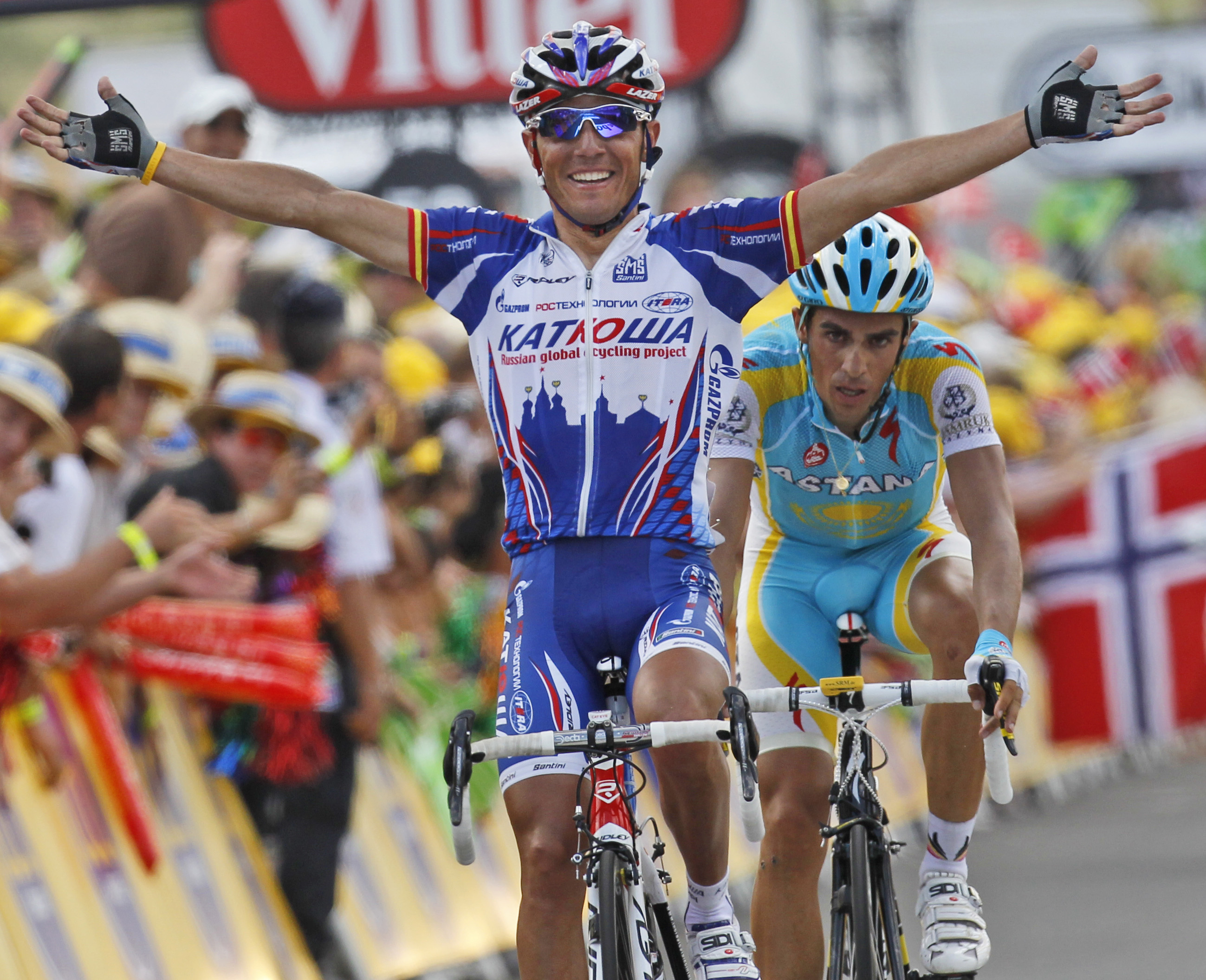 Joaquin Rodriguez Oliver of Spain, left, crosses the finish line to win the 12th stage of the Tour de France cycling race over 210.5 kilometers (130.8...