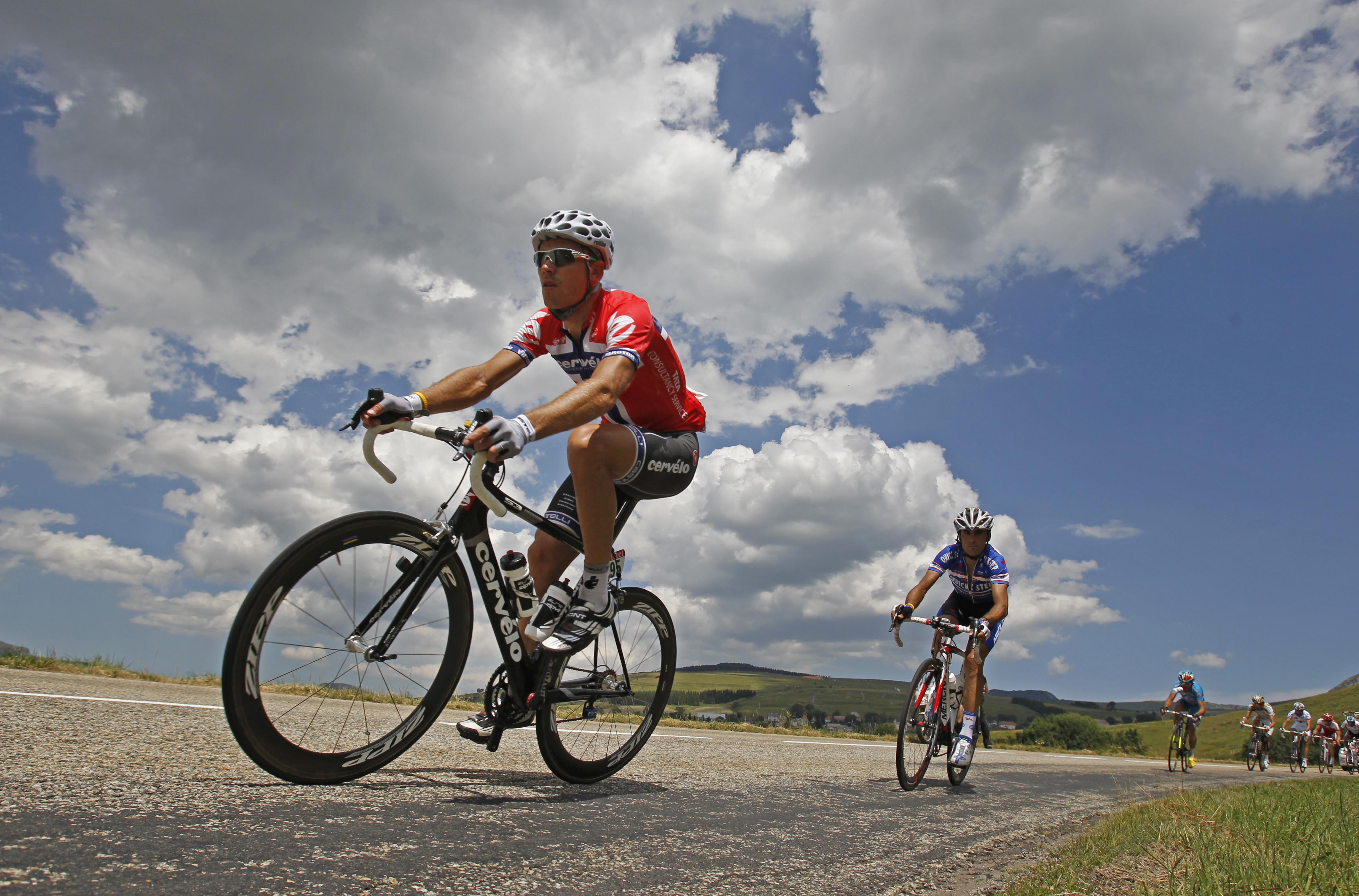 Thor Hushovd of Norway, left, rides in the breakaway group during the 12th stage of the Tour de France cycling race over 210.5 kilometers (130.8 miles...