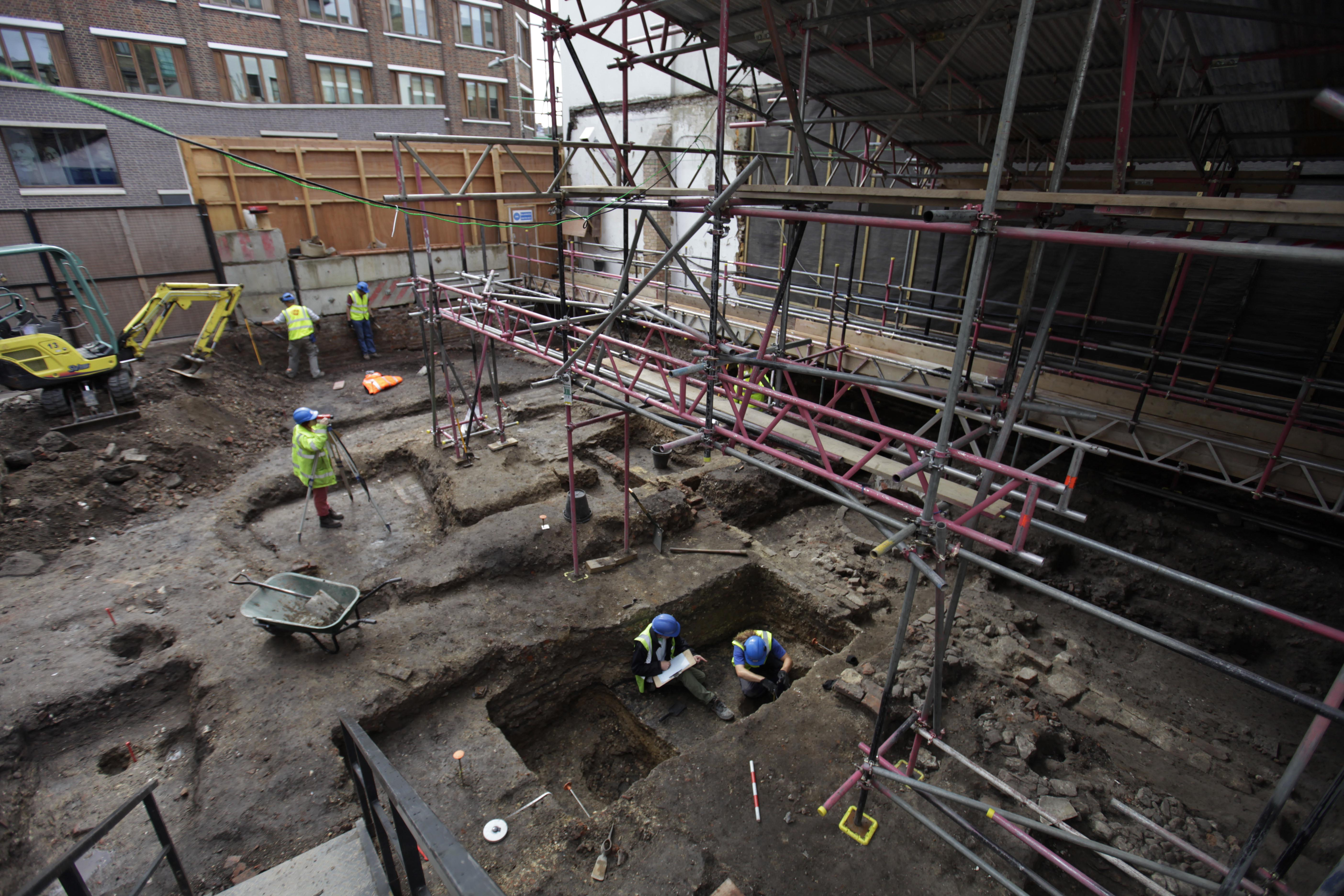 Archaeologists and workers work on an excavation site of London's first theater on July 15.