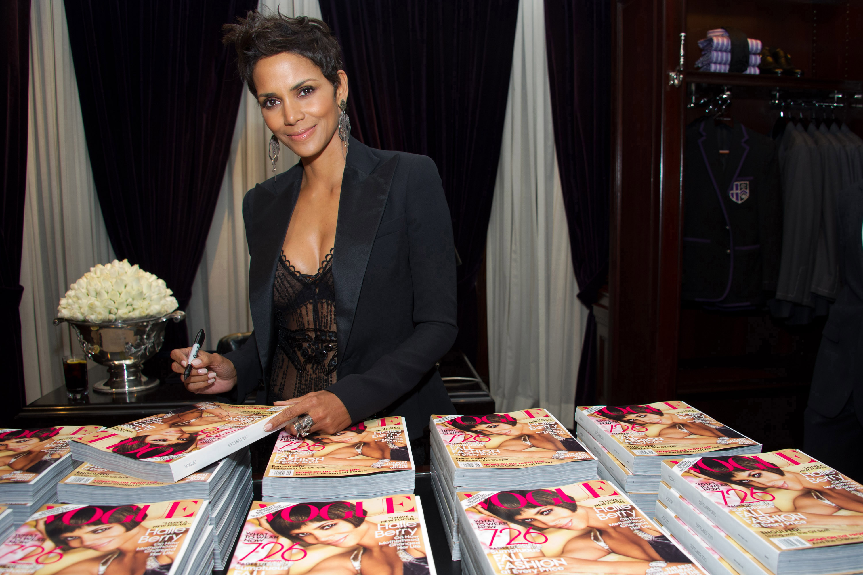 Halle Berry signs copies of her Vogue magazine cover at the Ralph Lauren Madison Avenue store for Fashion's Night Out in New York, New York on Friday.