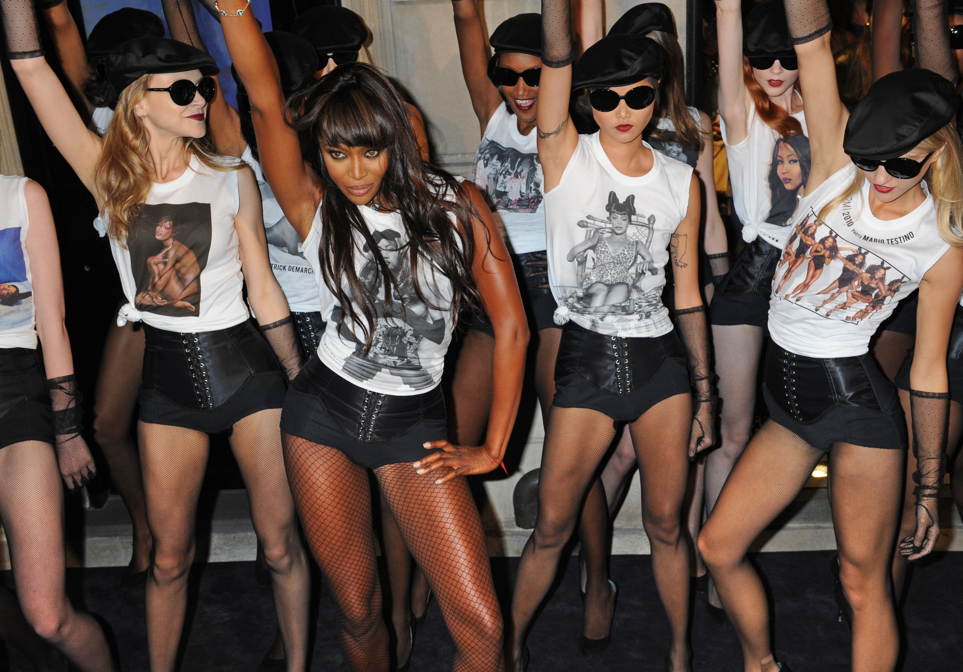 Naomi Campbell performs with models to celebrate the 25th anniversary of her career in front of the Madison Avenue Dolce & Gabbana store Friday in New...