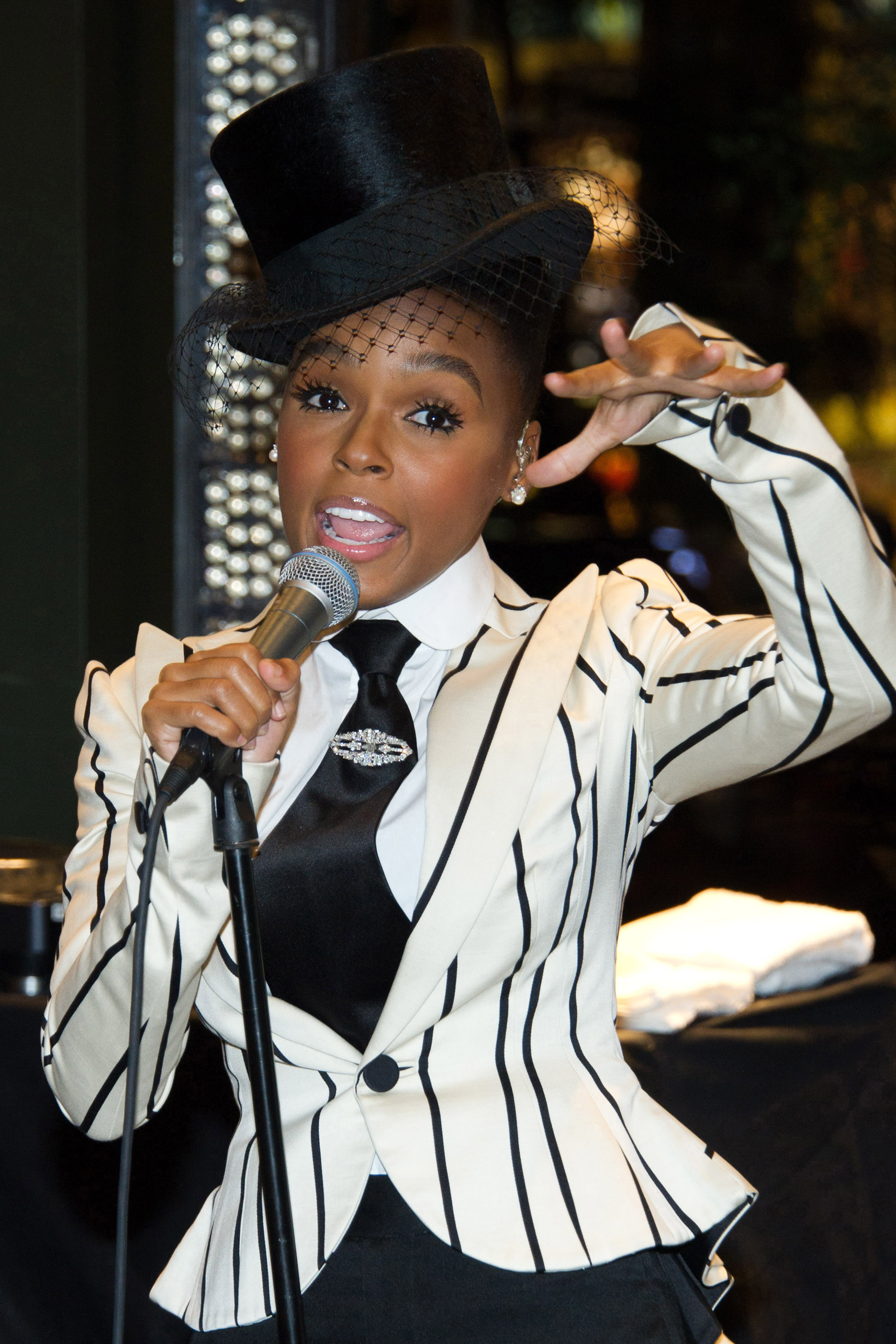 Janelle Monae performs at the Ralph Lauren Soho store for Fashion's Night Out in New York, New York on Friday.
