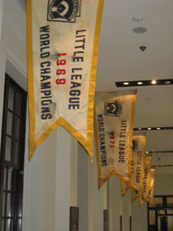 "Little League World Series championships flags won by Taiwan baseball teams are seen hanging from the rooftop in ""Taiwan Baseball Centennial"" exhibiti"