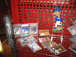 "Chen Chin-feng's bats and baseball cards, as well as bobblehead doll are seen displaying in the ""Taiwan Baseball Centennial"" exhibition which was held"