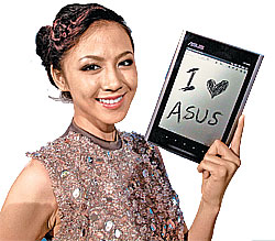 A model poses with an ASUS Eee Tablet in this undated file photo.