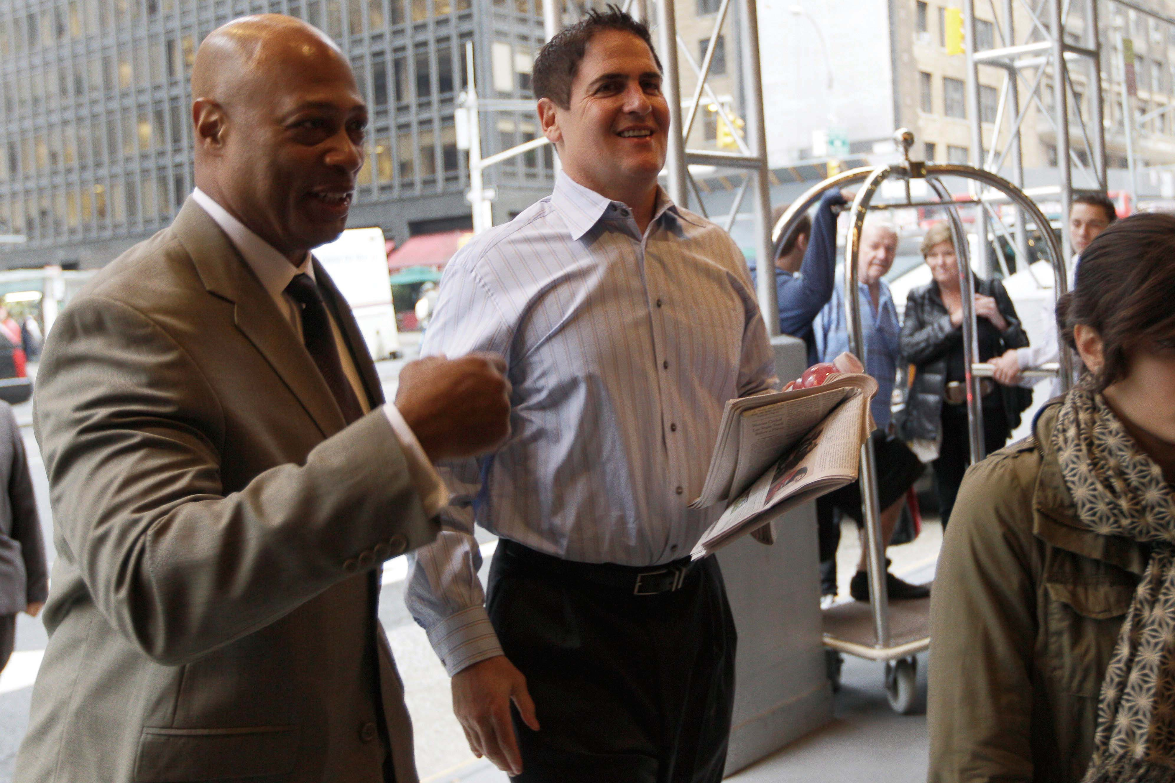 Dallas Mavericks owner Mark Cuban, right, arrives for labor talks between the NBA and players' association, Tuesday, Oct. 18, 2011 in New York.  (Asso...
