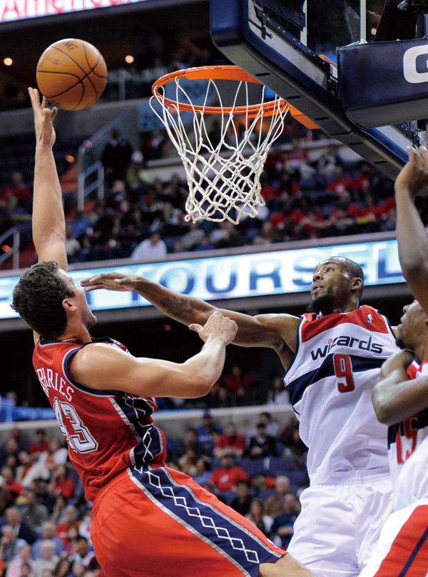 New Jersey Nets forward Kris Humphries (43) goes to the basket against Washington Wizards forward Rashard Lewis (9) during the first half of an NBA ba...