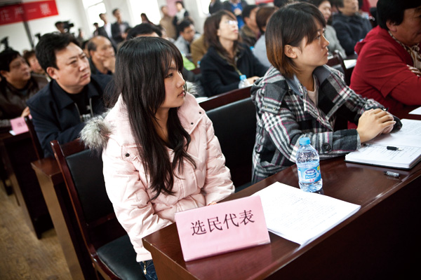 Voters invited by the government to participate in a news conference of independent candidates in Beijing, on Nov. 18, 2011. (The New York Times)
