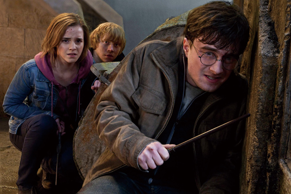 In this file film publicity image released by Warner Bros. Pictures, from left, Emma Watson, Rupert Grint and Daniel Radcliffe are shown in a scene fr...