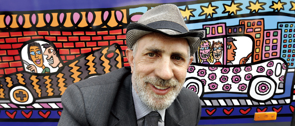 In this May 15, 2008 file photo, U.S. artist James Rizzi poses in front of a bus he painted, Mainz, Germany. (Associated Press)