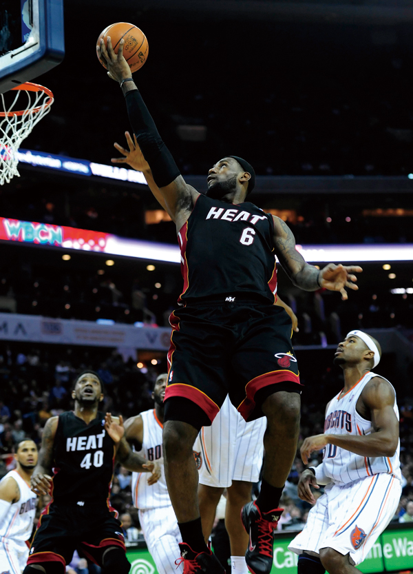 Miami Heat's LeBron James (6) goes in for a layup against the Charlotte Bobcats during the second half at Time Warner Cable Arena in Charlotte, North ...