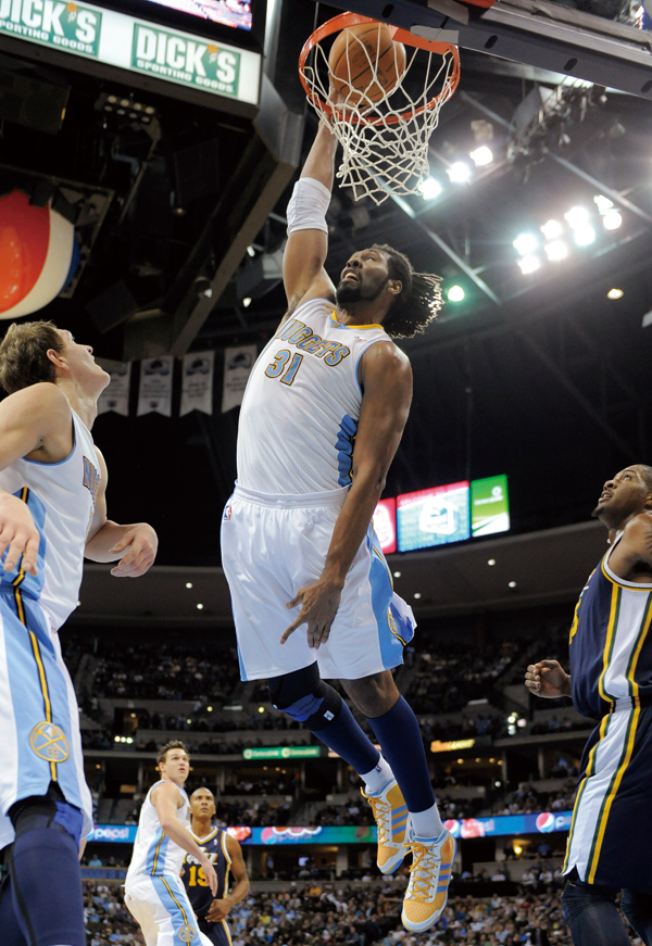 Denver Nuggets center Nene (31), from Brazil, dunks against the Utah Jazz during the third quarter of an NBA basketball game Wednesday, Dec. 28, 2011,...