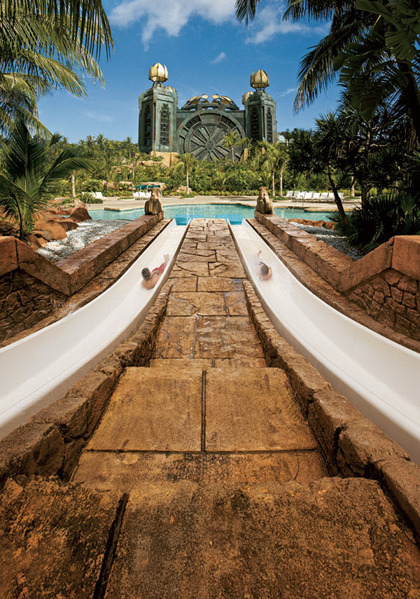 Guests can race down twin water slides at the Atlantis Paradise Island Resort in the Bahamas. (Minneapolis Star Tribune)