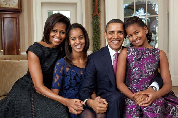 This photo provided by the White House, taken Dec. 11, 2011, shows President Barack Obama, first lady Michelle Obama, and their daughters, Sasha, righ...