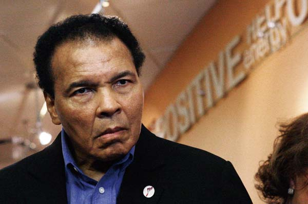 In this Thursday, Dec. 3, 2009 file photo, former heavyweight boxing champion Muhammad Ali tours the new Muhammad Ali Parkinson Center at Barrow Neuro...