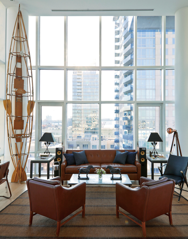 Inside the Peter Jenkins' penthouse, furnished with a couch from Mitchell Gold + Bob Williams, and a Klepper kayak from Dickinson's Antiques, at the E...