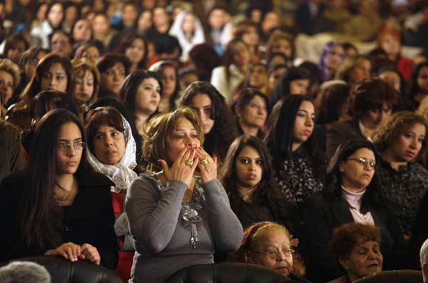 Women attend Christmas Eve mass, led by Coptic Pope Shenouda III at the Coptic cathedral in Cairo, Egypt, Friday, Jan. 6, 2012. (Associated Press)