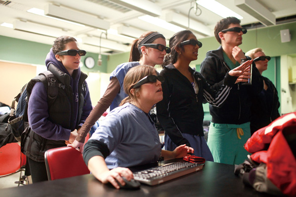 Students wear 3-D glasses while looking at a projected 3-D computer model of a human body during an anatomy class at the New York University School of...