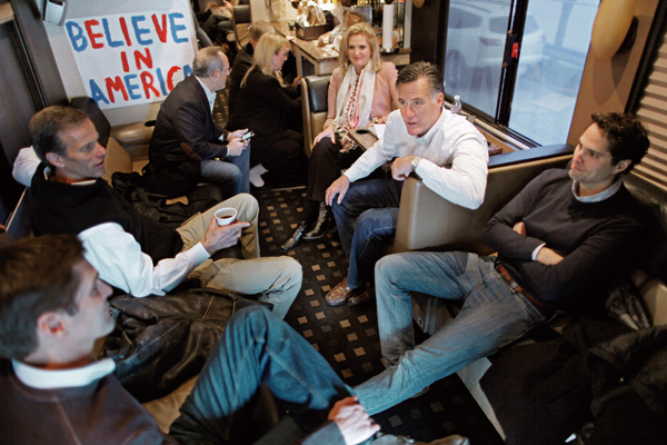 Former Massachusetts governor and Republican presidential candidate Mitt Romney (2nd R) sits with his sons Craig Romney (R) and Josh Romney, his wife ...