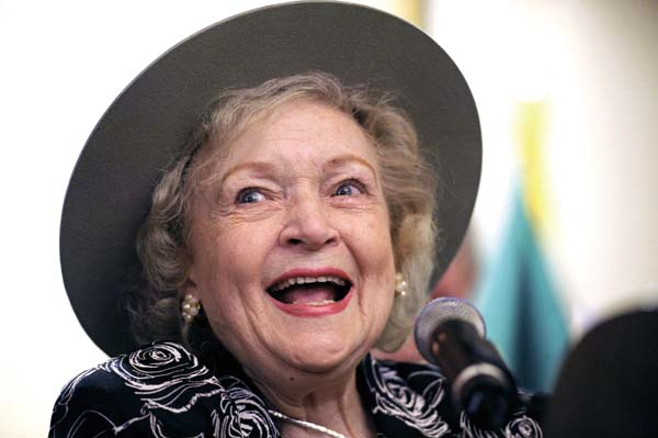 In this Nov. 9, 2010 file photo, actress Betty White wears a U.S. Forest Ranger hat after being named an Honorary Forest Ranger by the U.S. Forest Ser...