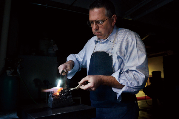 Bill Croll, senior designer modeler, is shown in the photo working on a sterling spoon prototype at Oneida, in Oneida, N.Y., Dec. 13, 2011. (The New Y...