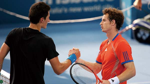 Andy Murray of Britain (R) shakes hands with Bernard Tomic of Australia (L) after winning their semi-final match at the Brisbane International tennis ...