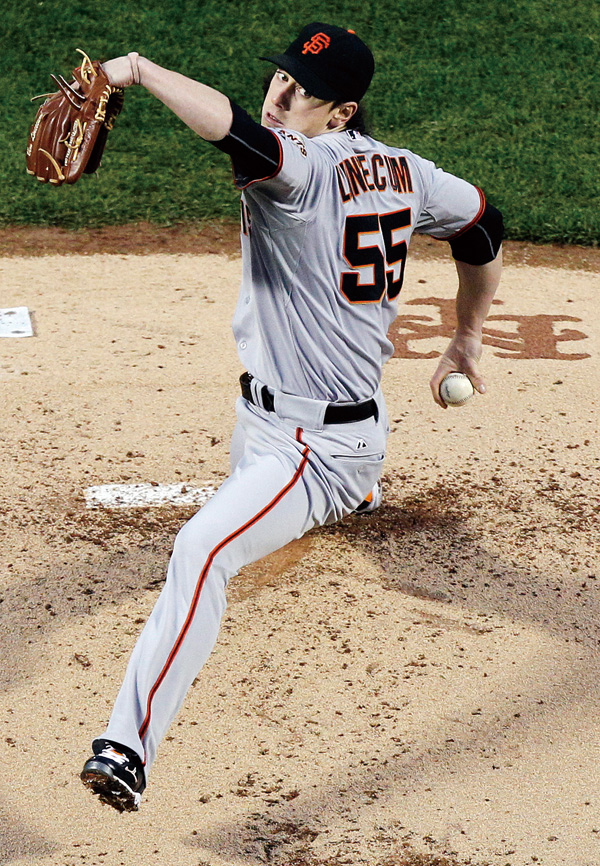 In this May 4, 2011, file photo, San Francisco Giants' Tim Lincecum (55) delivers a pitch during the first inning of a baseball game against the New Y...