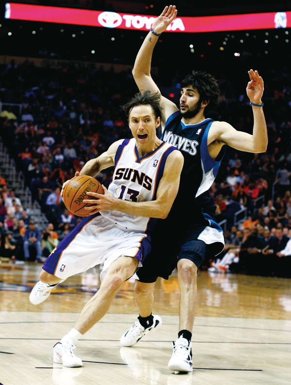 Phoenix Suns guard Steve Nash, left, drives past Minnesota Timberwolves guard Ricky Rubio, of Spain, in the third quarter of an NBA basketball game on...